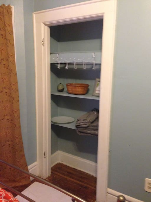 Closet with shelves and hooks.