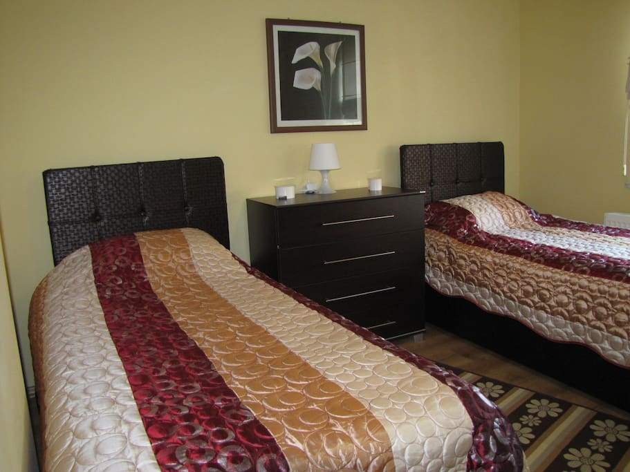 Bedroom  with two single or a double bed.