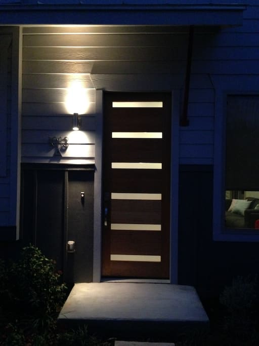 Custom made birch door makes for an inviting entryway.