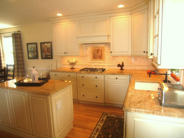 Gourmet kitchen with high end cabinetry, appliances and center Island.