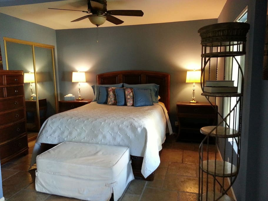 Fully furnished large bedroom with queen size bed.