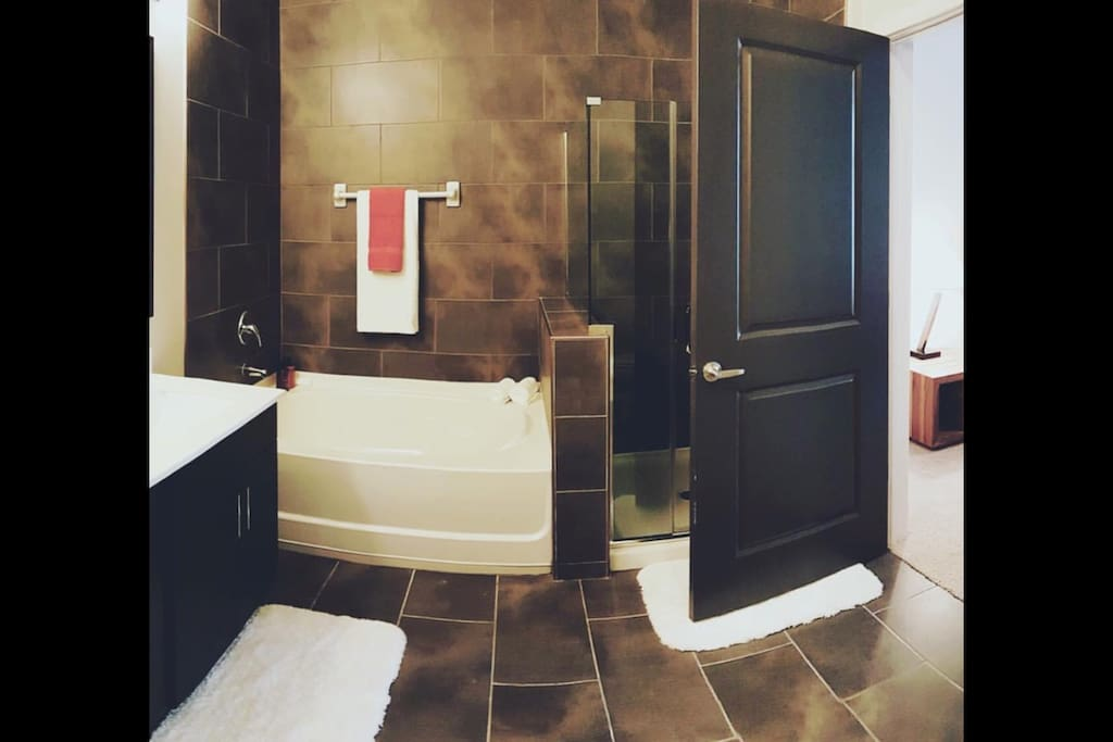 Full size restroom with a bathtub and walk-in shower. Clean towels and toiletries are included