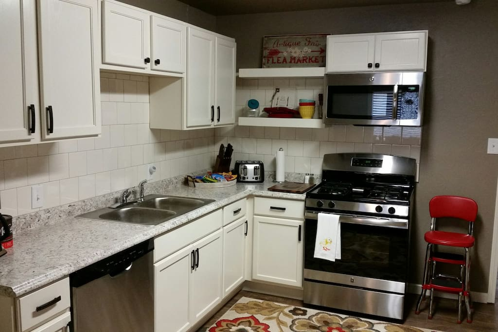 stainless appliances including Gas stove, microwave, dishwasher and refrigerator.