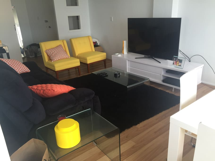 Comfortable lounge room to relax in front of huge TV with cable and wifi included!