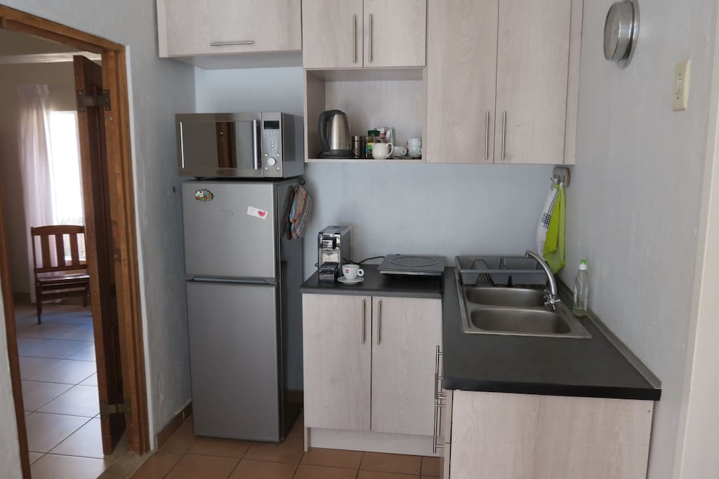 Kitchenette, with convection/microwave combination and a convection plate for cooking.