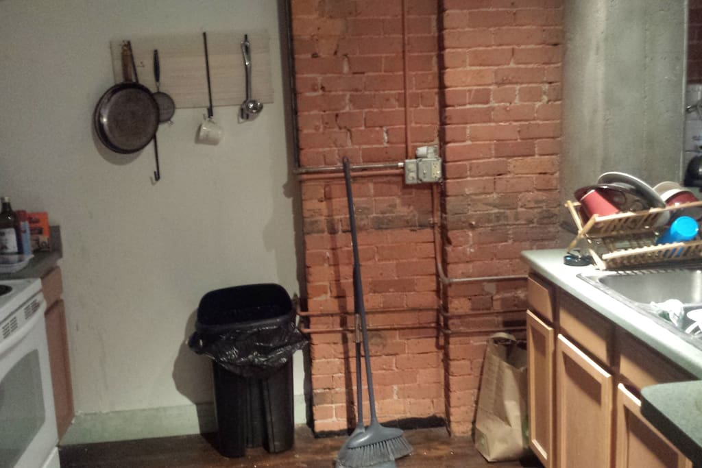 Full kitchen with refrigerator, stove and microwave.