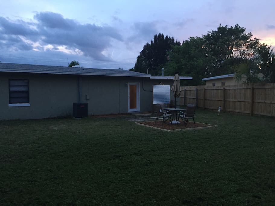 Back yard - large area for pets, fenced in, dining table and outdoor shower