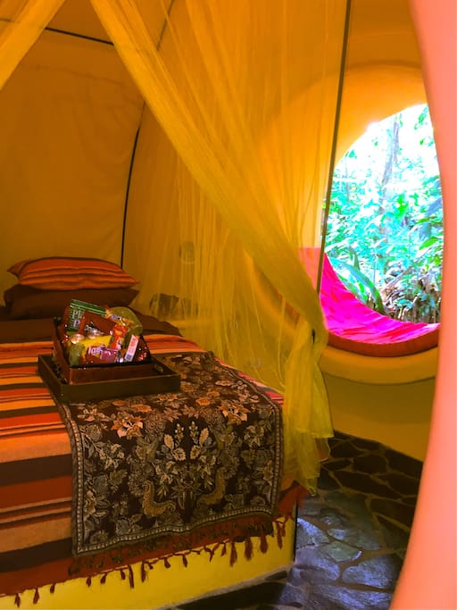 This is the bedroom featuring a queen size bed, ceiling fan, and mosquito net. This is a fully lockable room. Also, there is a safe mounted into cement for peace of mind while you are out.