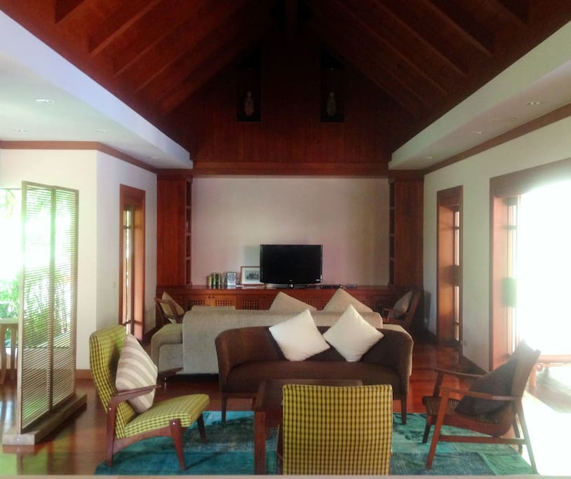 Living area in this Balinese-style villa. All floors are wood throughout.