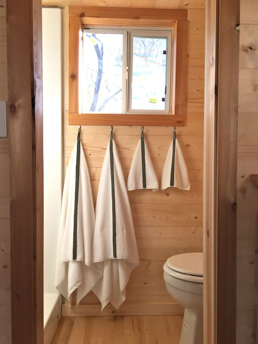 Enjoy a full-size shower and toilet in the tiny home during your stay.
