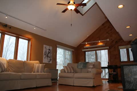 Great cathedral ceilings and skylights in living area