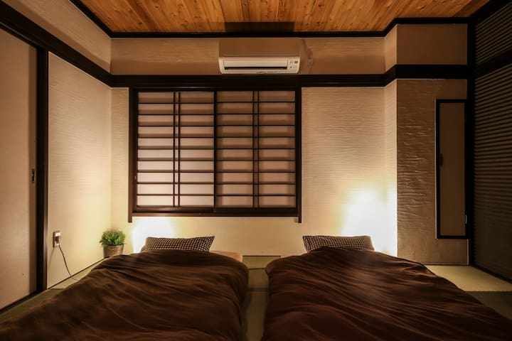 Japanese-style bedroom with mud wall (at night)