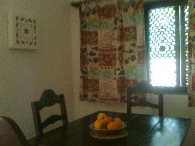 Inside luncheon space, enjoying portuguese - arabic influenced - window shadows. Retreating from heat!