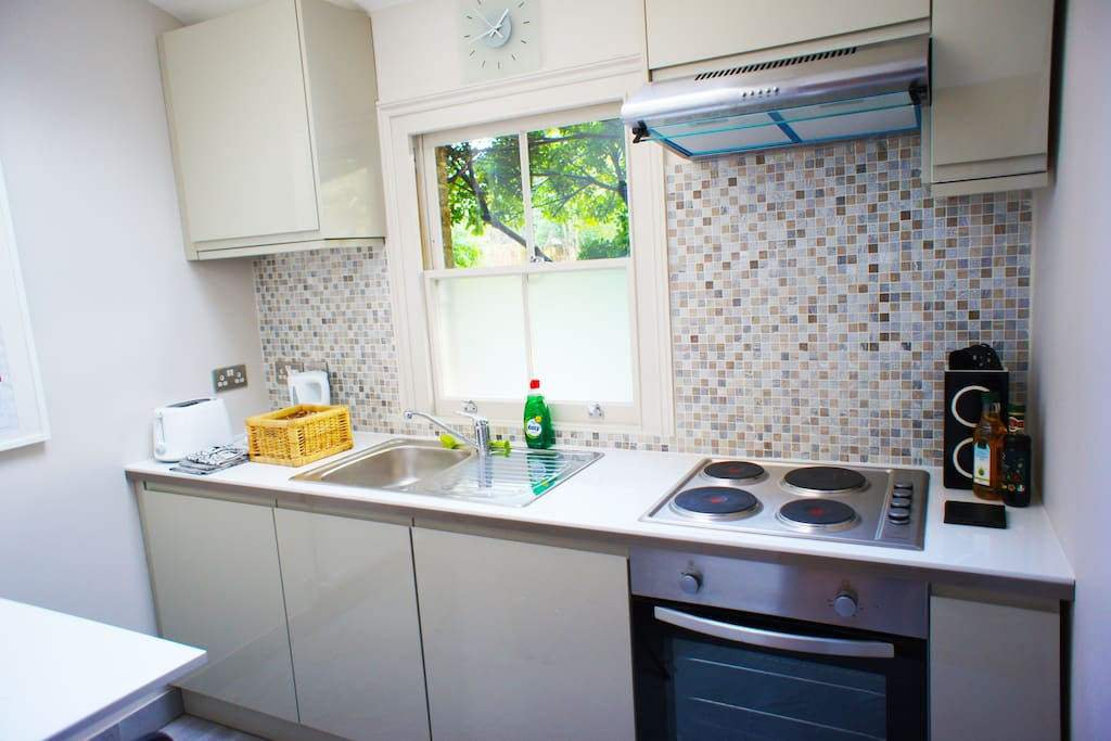 Private kitchen, fully equipped with dishwasher, fridge, cooker, crockery, cutlery, table & chairs