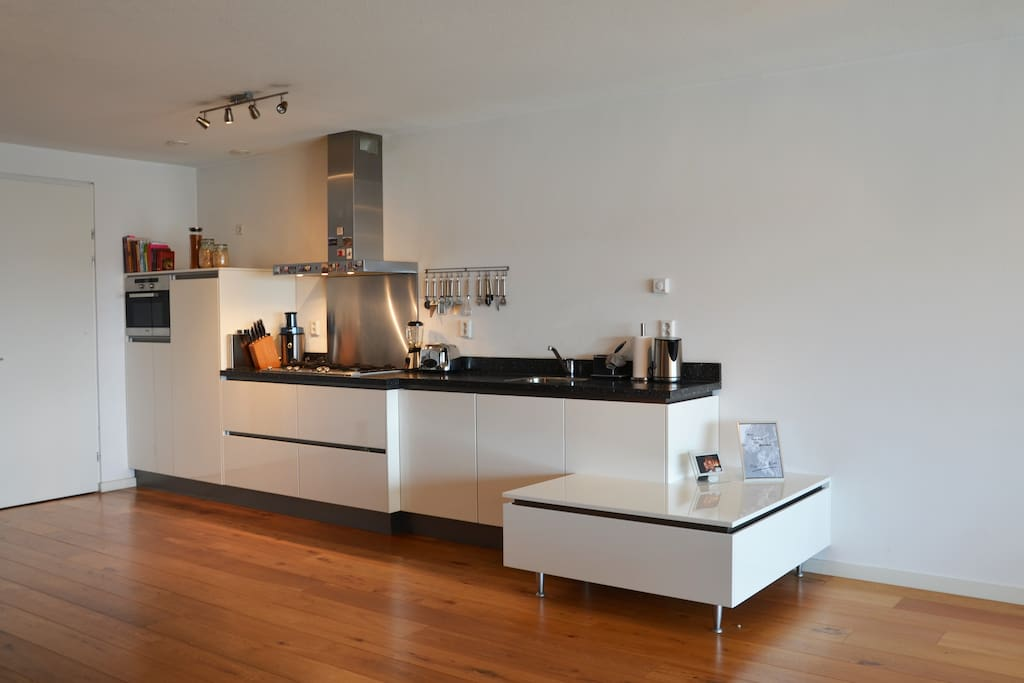 Kitchen with combi- microwave, oven, blender, juicer, toaster, dishwasher, water heater, coffee machine