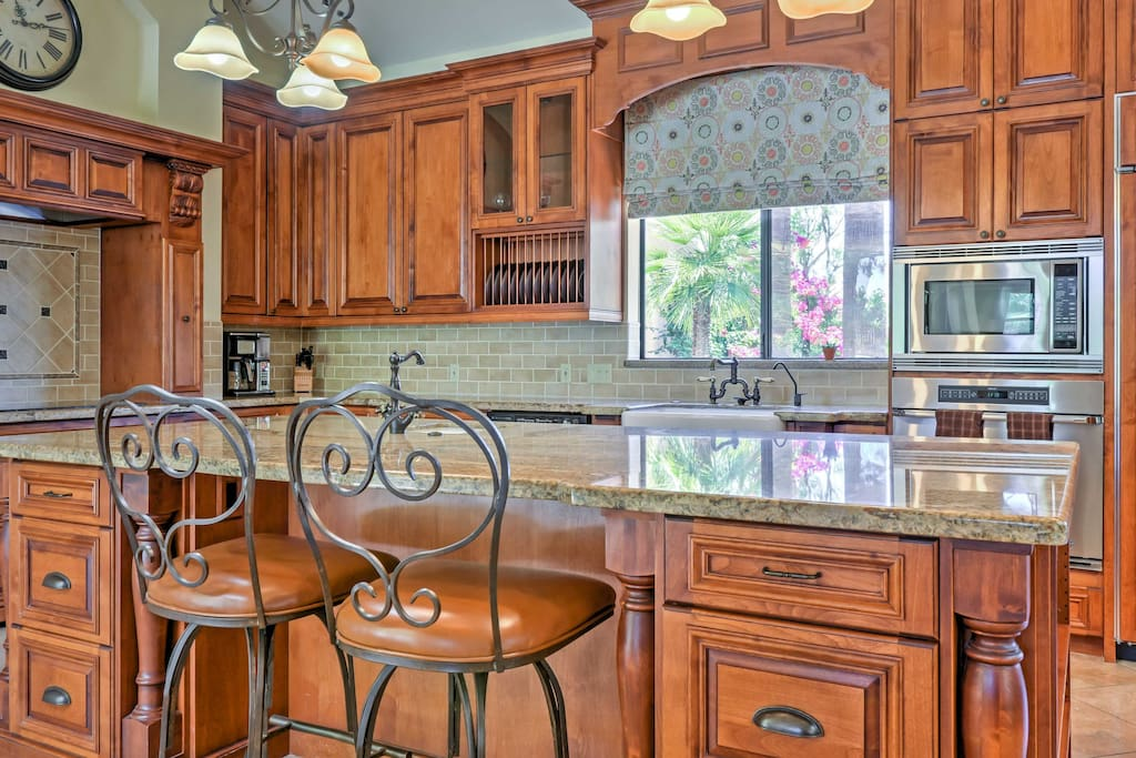 No detail was overlooked with this luxurious home! The chef's kitchen is a true culinary dream.