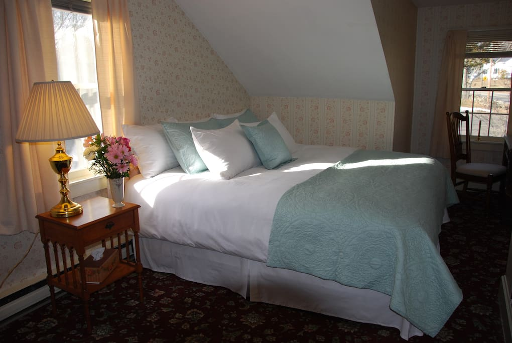 Room 7 has a king size bed with a west facing window for views of sunsets and the west expansive lawn