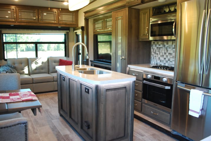 Wow! You just can't feel cramped in this spacious area. There's plenty of seating and plenty of storage space. And, yes, that's a full-size refrigerator!