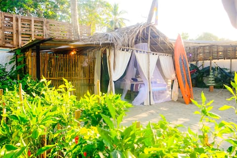 Eco-Glamping in Palm-Hut for 2 & under palm trees
