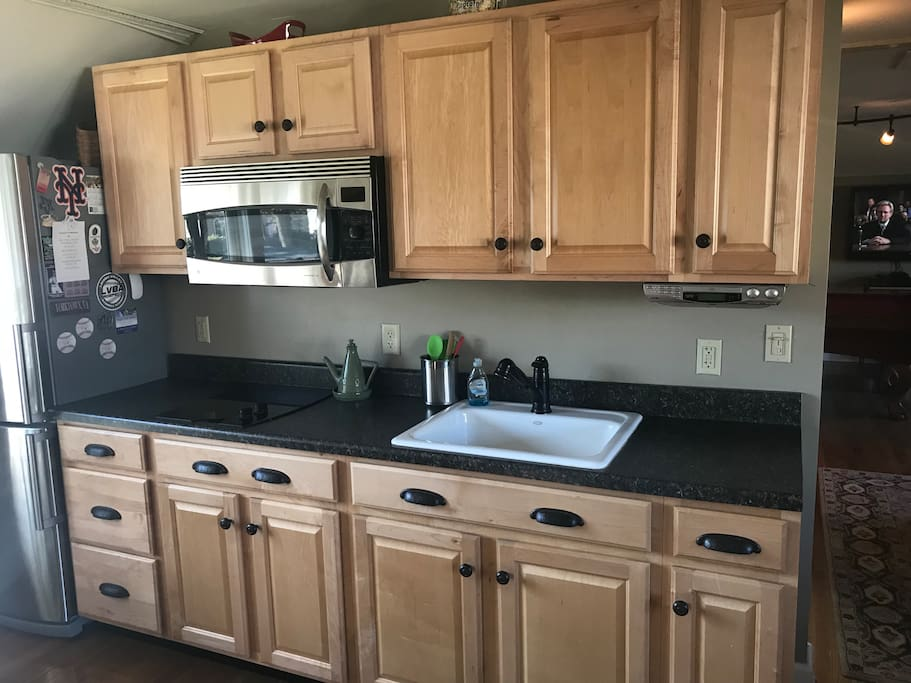 Full kitchen including convection oven/microwave stove top and refrigerator. Also included are dishes silverware and pots and pans for cooking!