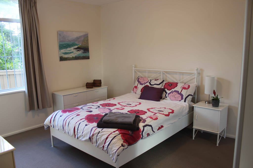 Plush double bed and blackout curtains for a great nights sleep, in a spacious room. Plenty of wardrobe and closet space, and floor to ceiling mirror.