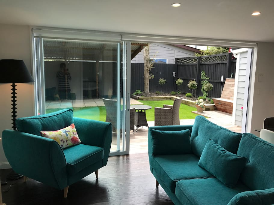 Open plan living to secure outdoor yard.