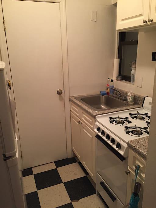 Kitchen with 4 burner stove, oven and full size fridge