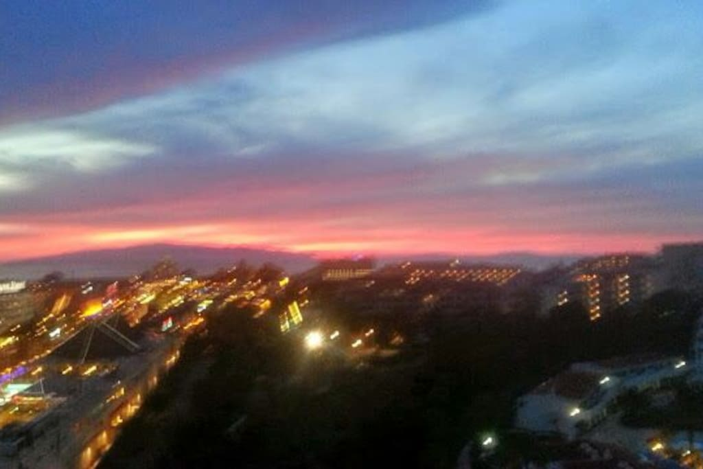 Sun goes down and night life begins in las Americas