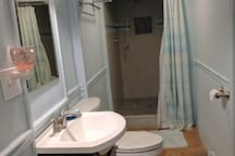 Bathroom is located just steps from the bedroom.