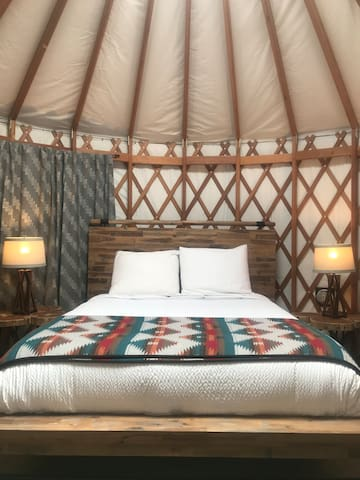 Left side of Yurt: Queen size bed with new memory foam mattress