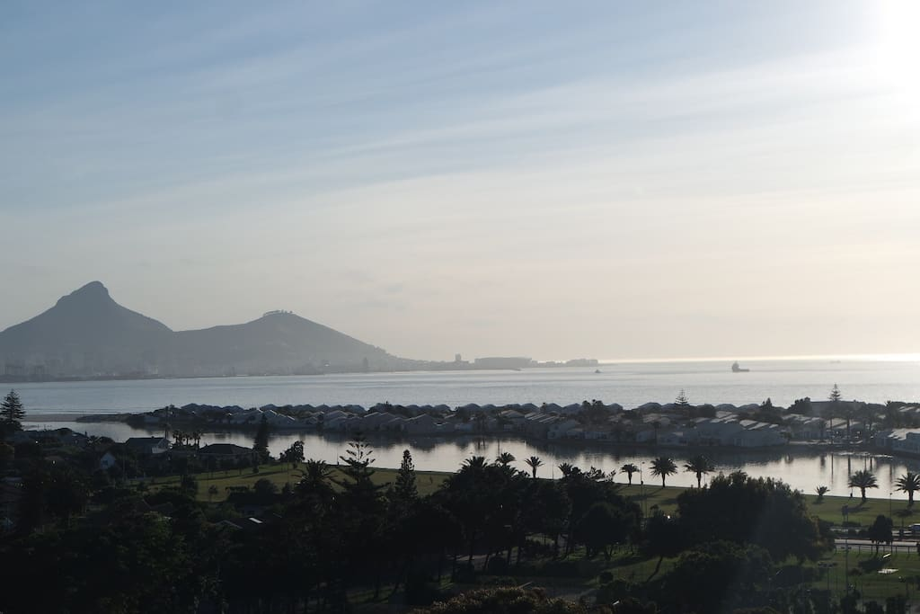 View from the apartment over the lagoon and across the bay with Lion's Head and Signal Hill.