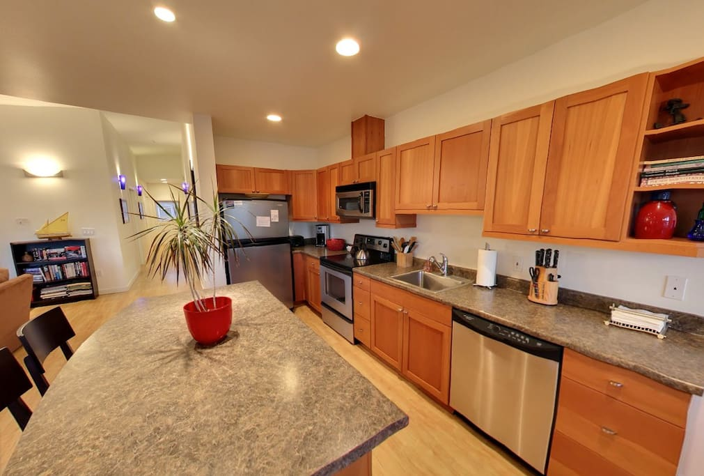 Kitchen adjoins the living room. Seating at both the kitchen island and dining table.