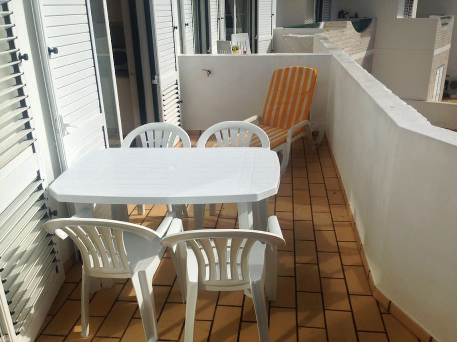 Easily seat 4 around the table on the balcony with a sun lounger out also