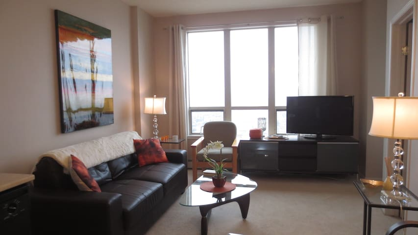 The open concept living area is hospitable for making meals, taking in beautiful sprawling views & unwinding way above the hustle & bustle down below