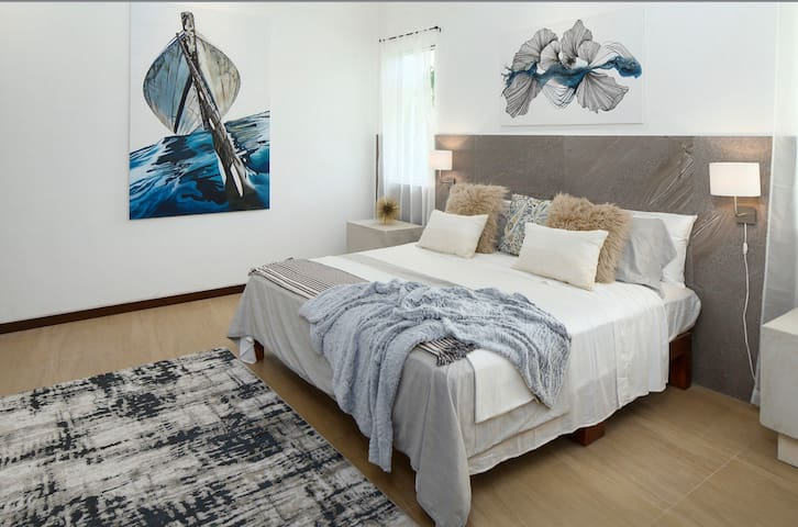 The second bed also features a king sized bed, tastefully decorated with artwork from a local artist.