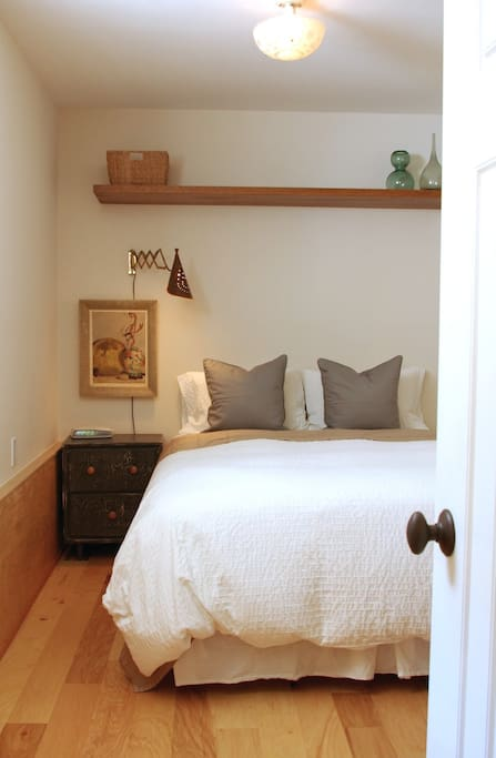 Bedroom has queen size bed with high quality mattress. Feather duvet and pillows.
