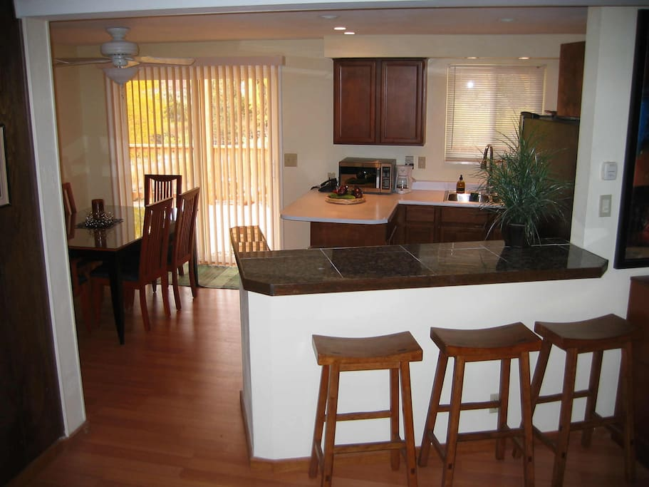 All new appliances in dining room, sliding door to back deck.