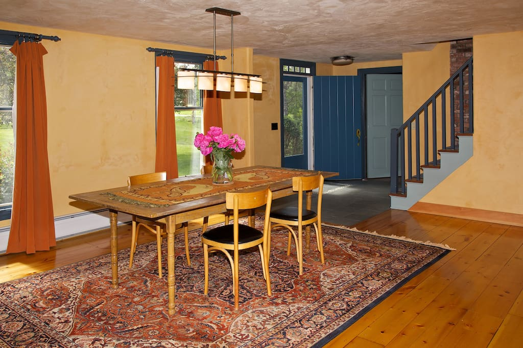 Open dining room. Antique table seats 8.
