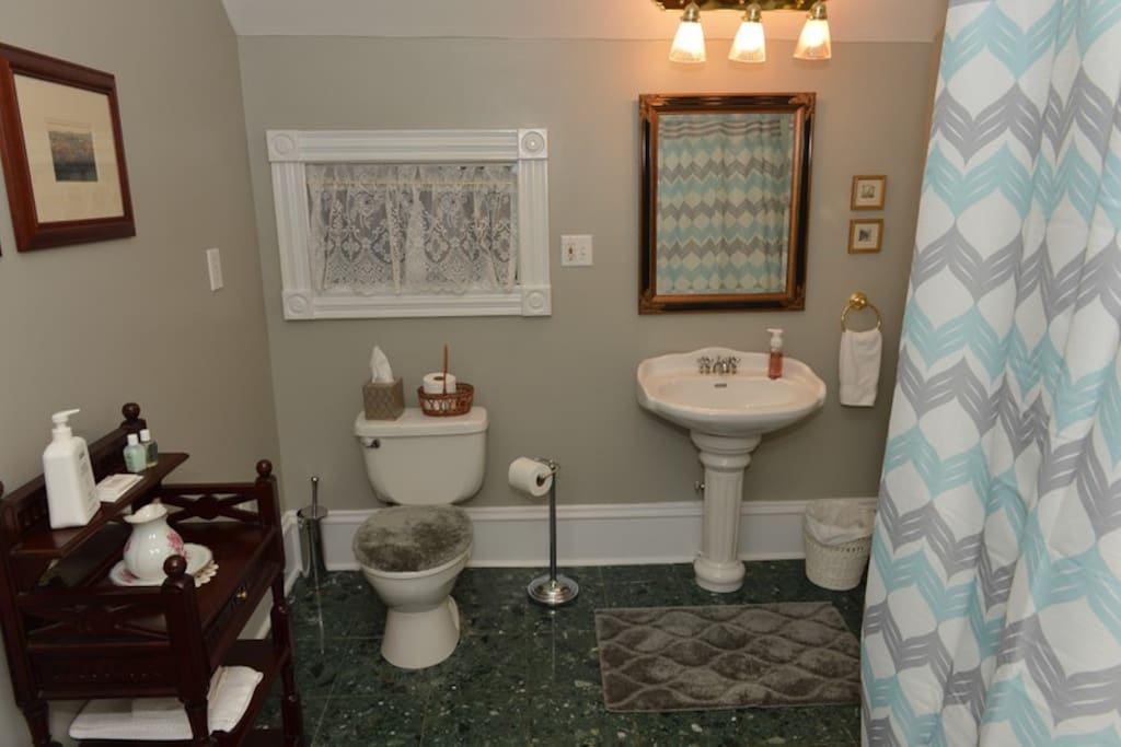 Private bathroom is located across the hall from bedroom