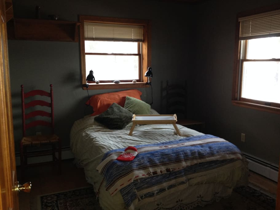 Cozy bedroom facing the lake with hot water bottles for your feet!  Coffee and tea supplied.