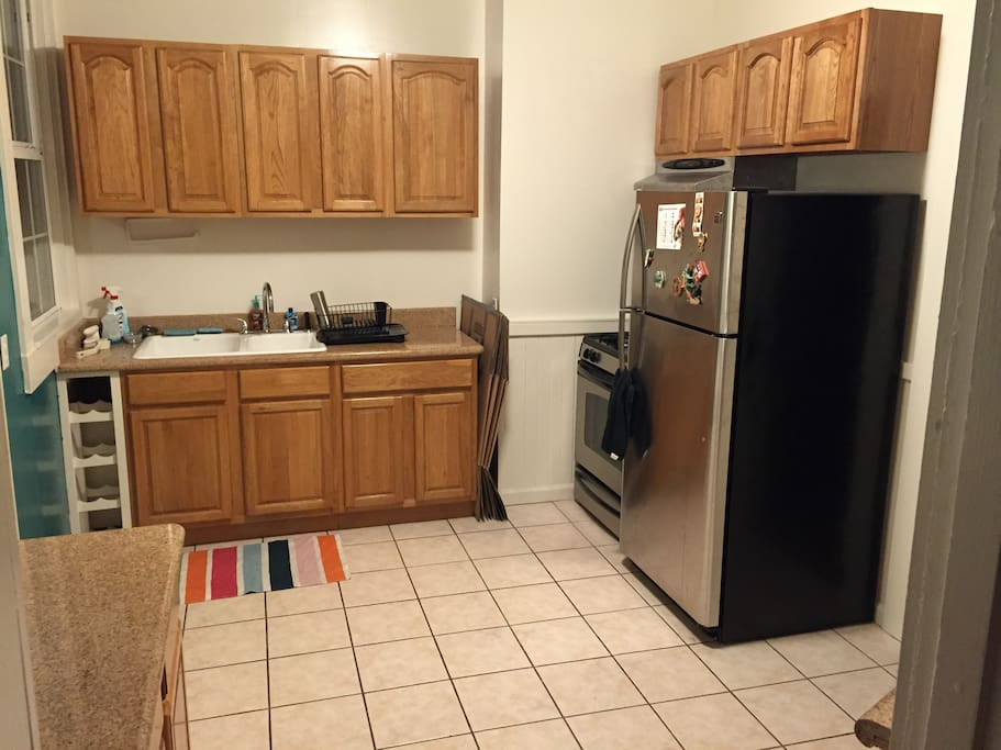 Full service kitchen with fridge, freezer and microwave