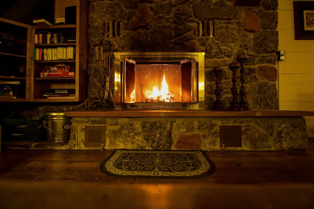 Warm cozy old fashioned wood fireplace.