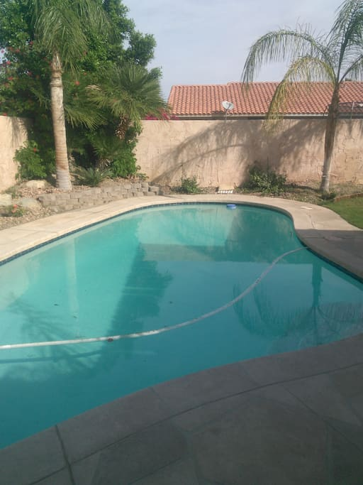 Full view of pool, with lawn off to the right.  your private backyard !!!