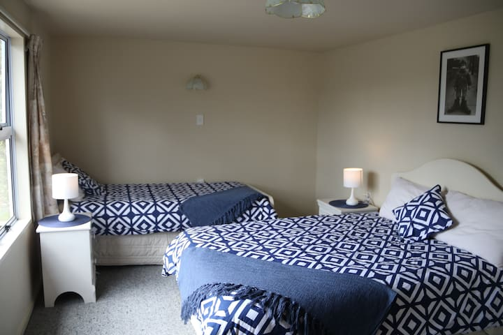 Bedroom two - contains one double bed and one single bed.