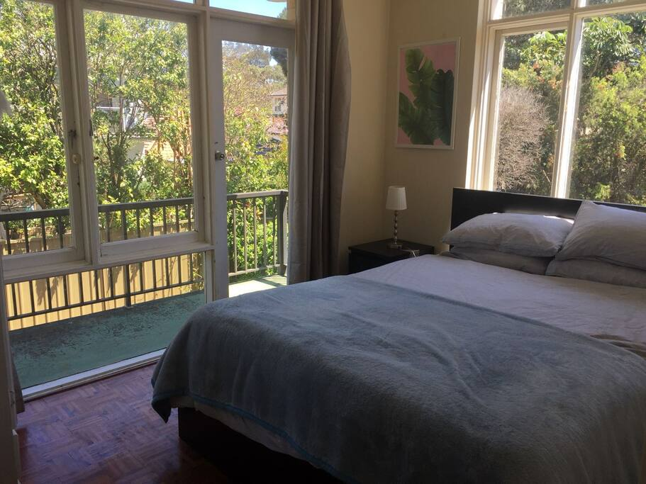 2nd Bedroom with Queen sized bed and balcony view.
