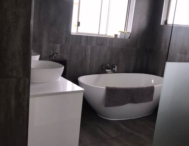 Ensuite (off main bedroom) large and modern with open shower, bath and double basins