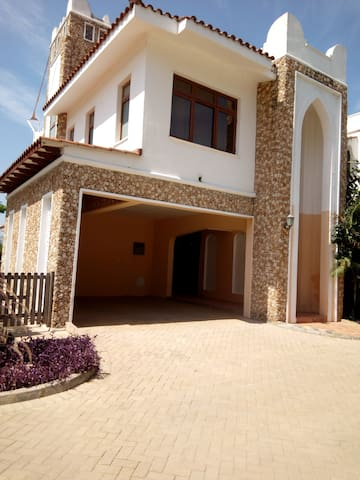 4BR villa with gym and pool opp SERENA hotel.