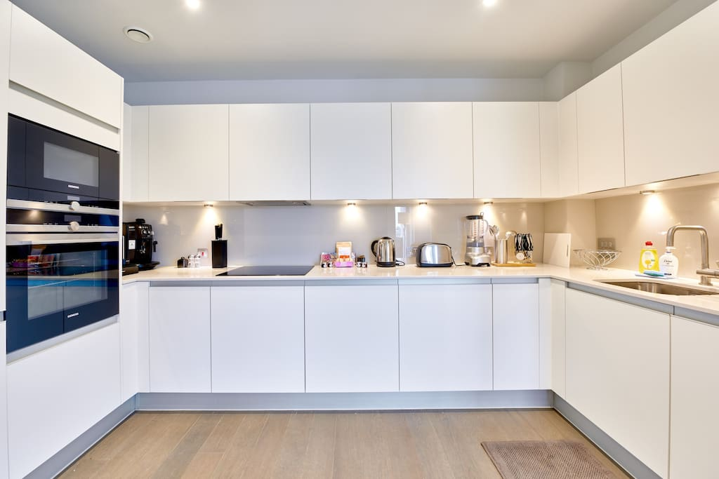 The sleek kitchen has everything you need, with mod cons and plenty of storage space
