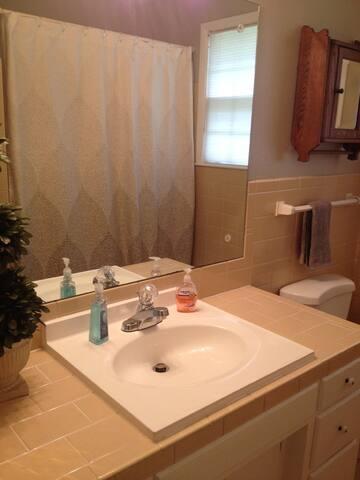 Charming hall bath with full size tub.