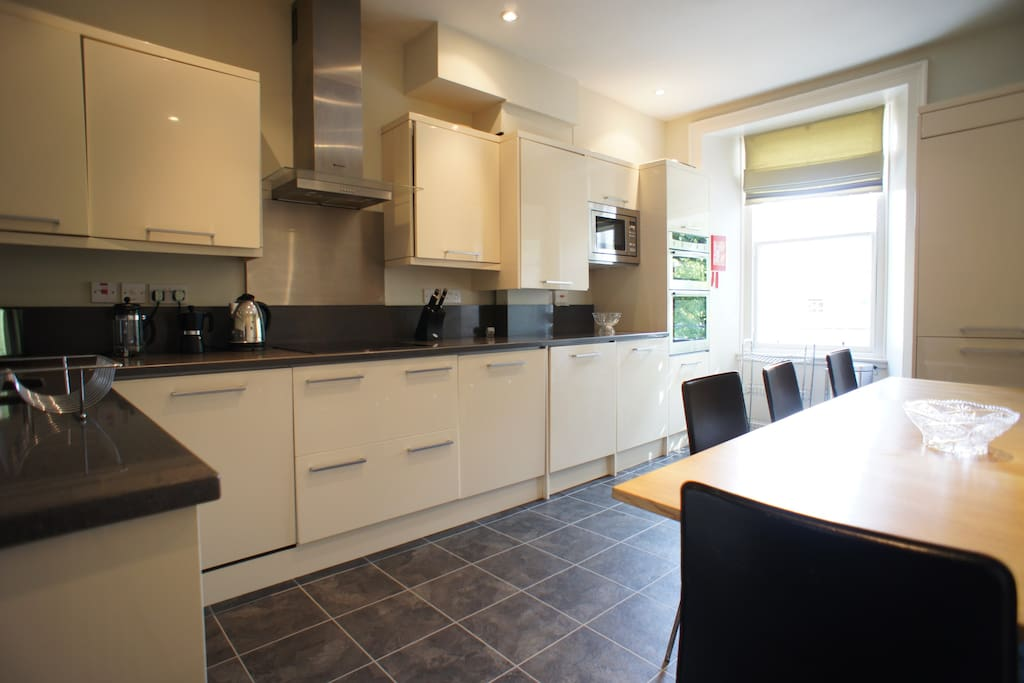 Well appointed kitchen with dining for nine